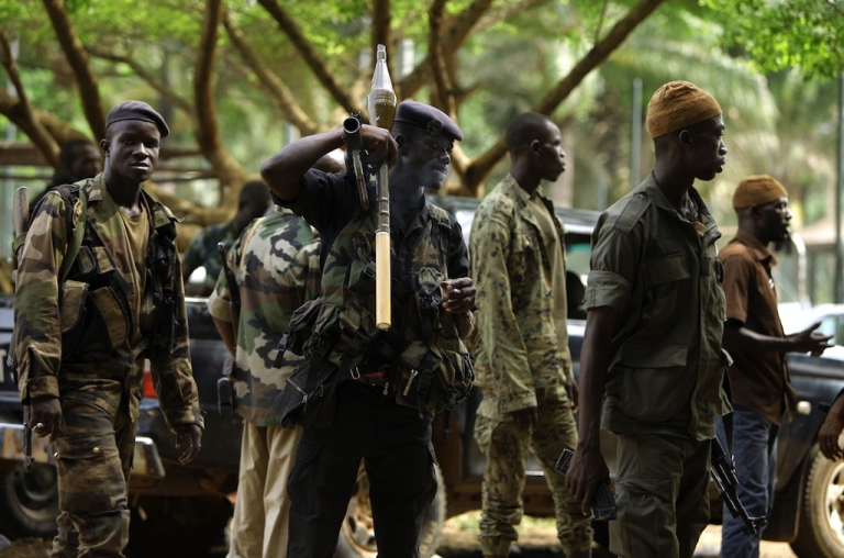 <p>Members of forces loyal to Ivory Coast's internationally recognized president Alassane Ouattara stand ahead of an attack on the residence of former strongman Laurent Gbagbo in Abidjan on April 6, 2011.</p>