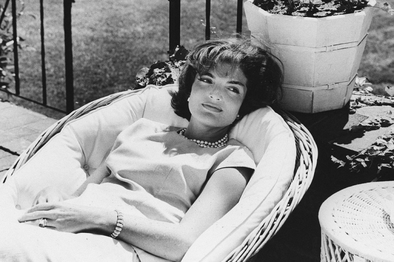 <p>U.S. First Lady Jacqueline Kennedy relaxing in a chair in December 1961, a few weeks after John F. Kennedy won the presidency.</p>