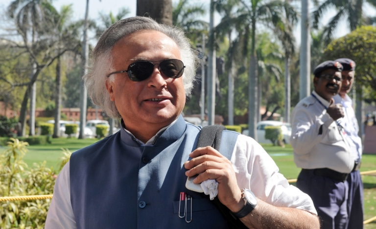 <p>In this photograph taken on March 6, 2011, Indian Environment Minister Jairam Ramesh shares a comment with journalists on unseen left-party members of parliament demonstrating against the 2011-2012 national budget in front of parliament house in New Delhi. India's maverick environment minister Jairam Ramesh is more than a little smug that at one time or another he has raised the hackles of big business, cabinet colleagues and environmentalists.</p>