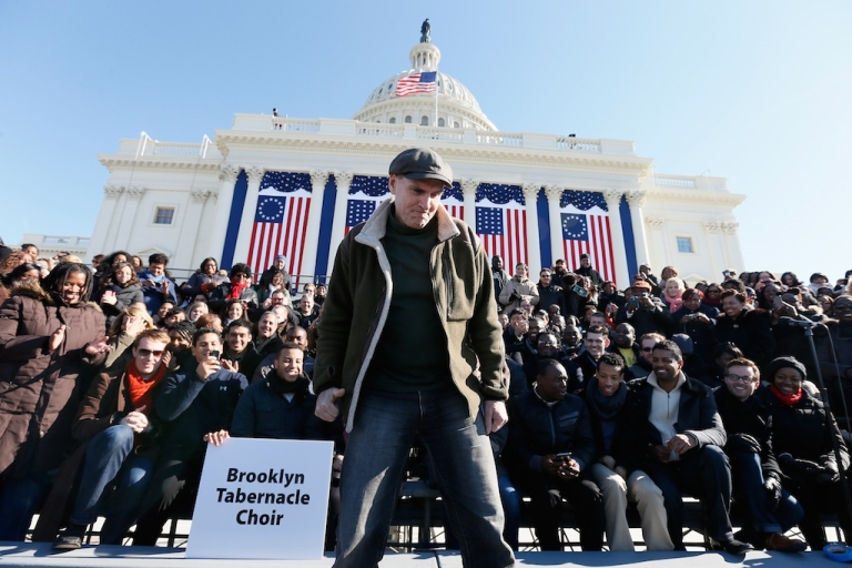 <p>Musician James Taylor stands before the Brooklyn Tabernacle Choir at the US Capitol building during rehearsal as Washington prepares for President Barack Obama's second inauguration on Jan. 20, 2013 in Washington, DC</p>