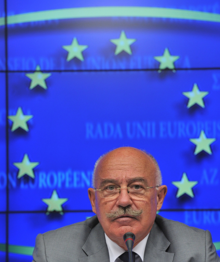 <p>Hungarian Foreign Minister Janos Martonyi surrounded by the stars of the EU.  The EU is demanding the Hungarian government restore independence to its central bank as a condition of backing its request for bailout funds from the IMF.</p>