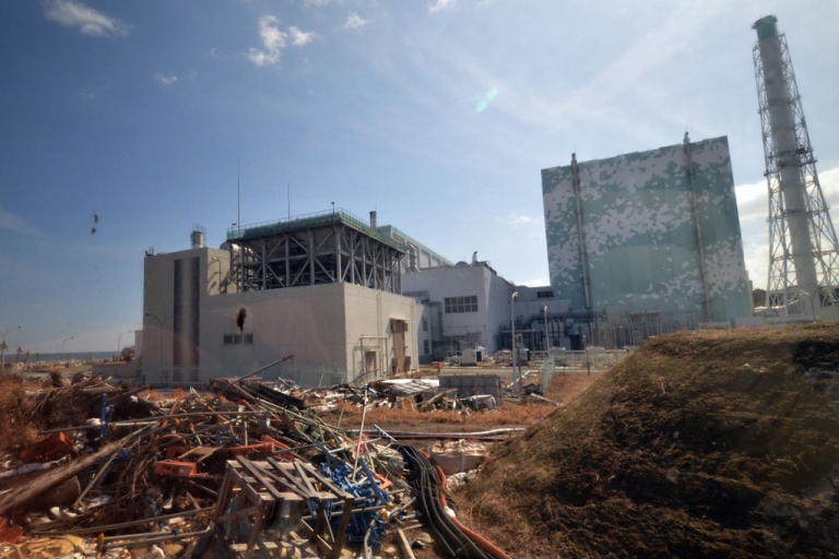 <p>Debris scattered before the sixth reactor building of stricken Tokyo Electric Power Co (TEPCO) Fukushima Dai-ichi nuclear power plant to the journalists at Okuma town in Fukushima prefecture, northern Japan on Feb. 28, 2012.</p>
