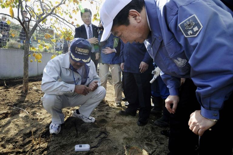 <p>Japanese Prime Minister Yoshihiko Noda looks at radiation being measured in Fukushima City, Fukushima prefecture, Oct. 18, 2011.</p>