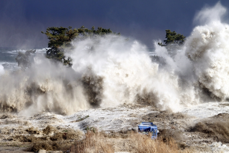 <p>Tsunami waves hit the coast of Minamisoma in Fukushima prefecture on March 11, 2011.</p>