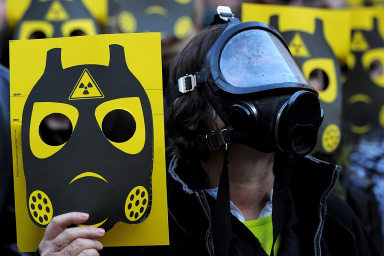 <p>Anti-nuclear activists participate in a demonstration on March 17, 2011 in Sant Jaume square, in Barcelona. Thousands of anti-nuclear demonstrators, in reaction to the dramatic situation at the Fukushima nuclear facility in Japan, gathered in cities across Spain to protest the government-granted extension of the operational lives of Spain's older nuclear power plants.</p>