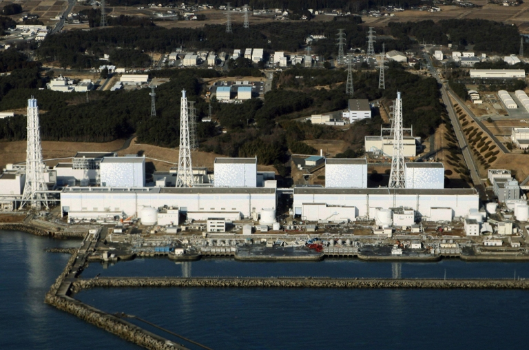 <p>An aerial view shows the quake-damaged Fukushima nuclear power plant on March 12, 2011.</p>