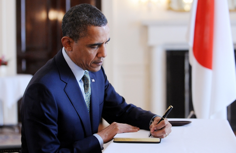 <p>U.S. President Barack Obama makes an entry in a book of condolences during a surprise visit to the Japanese embassy March 17, 2011, in Washington D.C. Japan is struggling to contain a potential nuclear meltdown resulting from the powerful earthquake and tsunami last Friday and subsequent aftershocks.</p>
