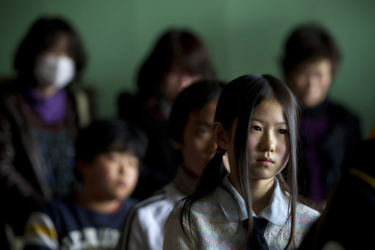 <p>Saya Takahashi,12, sits in class during an emotional graduation ceremony for the 6th grade at the Ohya Elementary school March 23, 2011 in Kesennuma, Japan.</p>