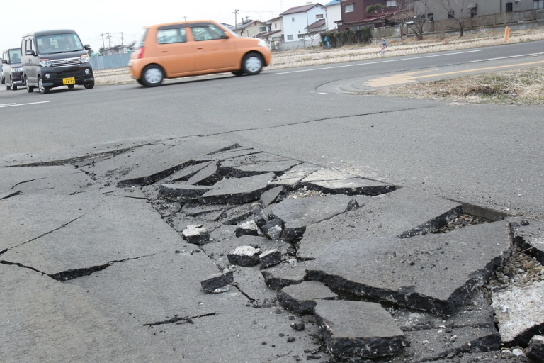 <p>A damaged road is seen on March 13, 2011, in Sendai, Japan, after an 8.9 magnitude earthquake struck on March 11 off the coast of northeastern Japan.</p>