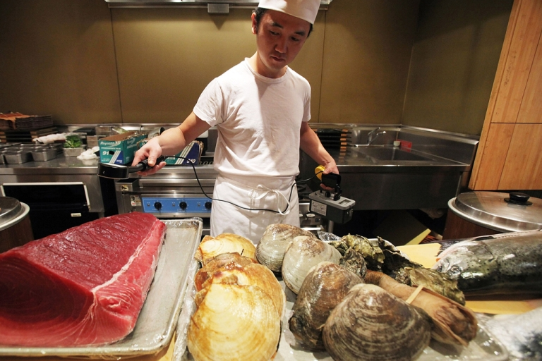 <p>A sushi chef uses a radiation detector on seafood before it is prepared in Manhattan's Sushi Yasuda restaurant.</p>