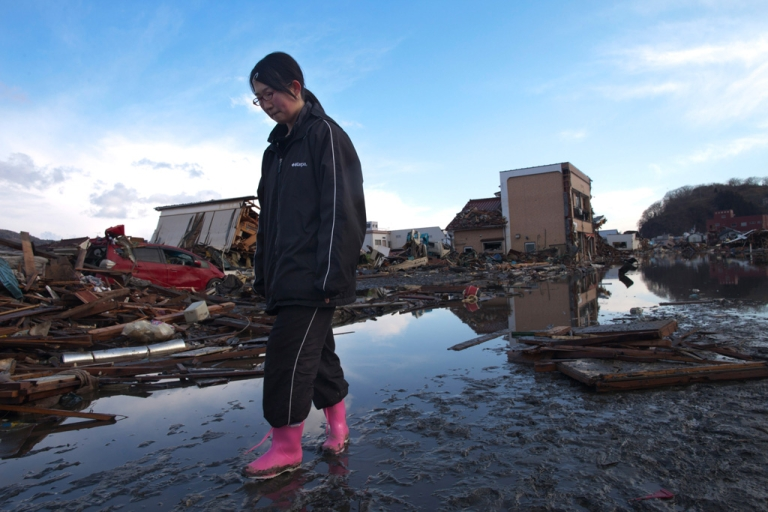 <p>A Japanese girl stands amongst the rubble where her home had been, while visiting it for the first time on March 18, 2011 in Kesennuma, Japan.</p>
