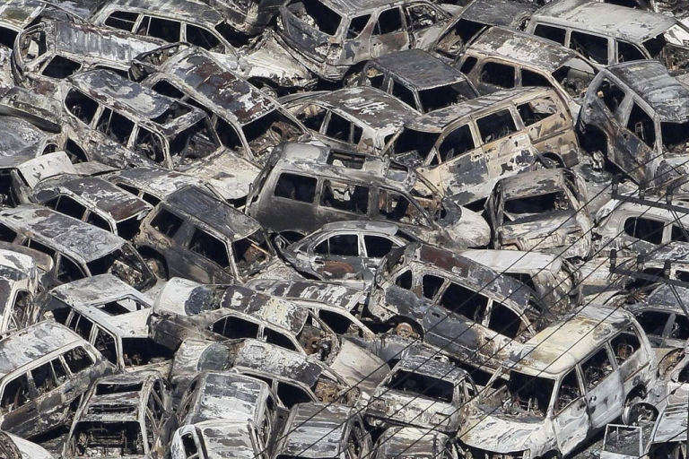 <p>In a picture taken March 12, 2011, tsunami-damaged vehicles that were parked for export are piled at a port in Ibaraki prefecture, Japan.</p>