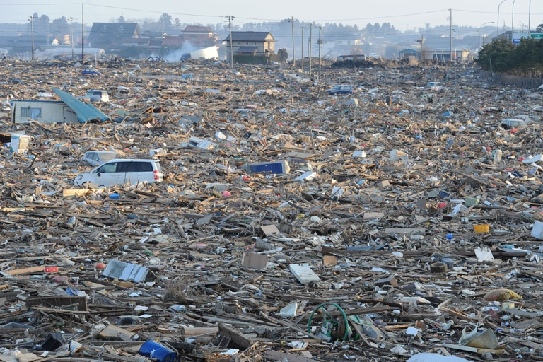 <p>Debris cover a large area in Natori, near Sendai in Miyagi prefecture on March 13, 2011 after the March 11 earthquake and tsunami.</p>