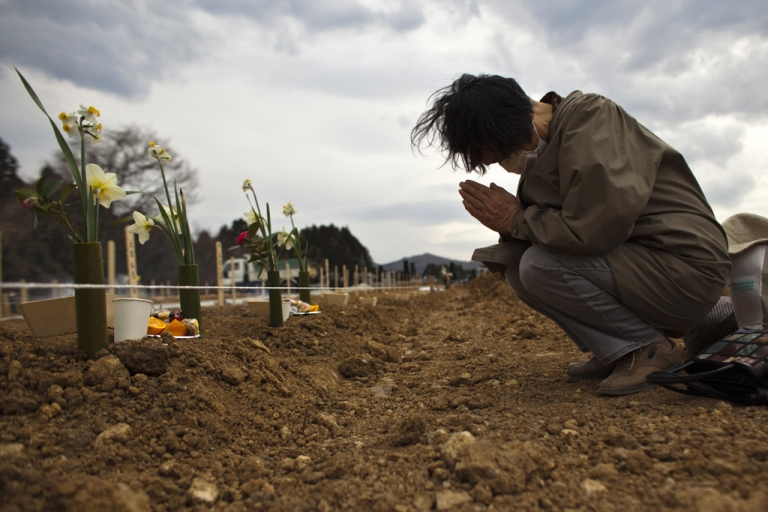 <p>A relative pays her respects to an earthquake victim in Yamamoto, Miyagi Prefecture, Japan.</p>