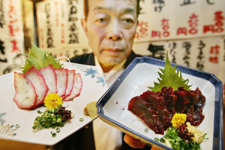 <p>Shunichi Arita, manager of Japanese-style restaurant chain Taruichi, serves whale sashimi at his restaurant in Tokyo's red-light district Kabukicho.</p>