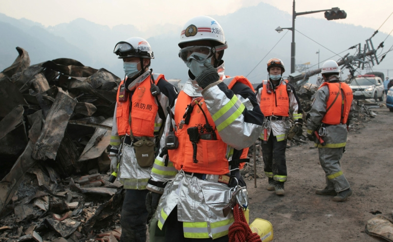 <p>Firefighters join search and rescue efforrts on the northeast coast of Japan on March 14, 2011.</p>