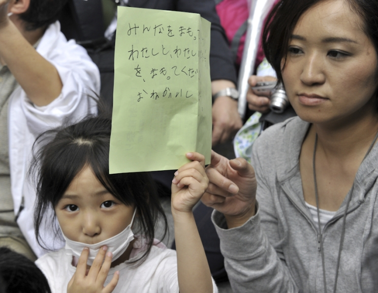 <p>A girl holds her petition to ask the education ministry to protect children from radioactive contamination at Fukushima prefecture during a rally at the Education Ministry in Tokyo on May 23, 2011. Some 400 civic group members, including 60 parents and children from Fukushima, demanded to review the radiation limit of 3.8 microsieverts per an hour as the education ministry has set a radiation limit to allow children in Fukushima.</p>
