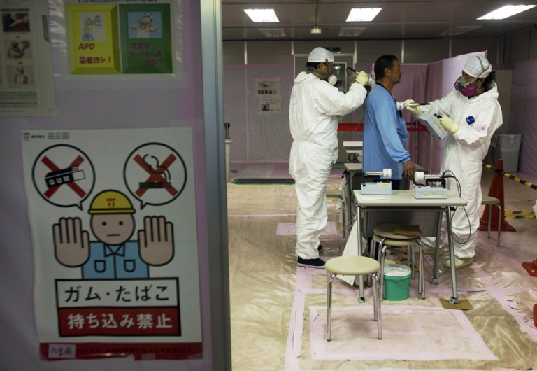 <p>A workers is given a radiation screening as he enters the emergency operation center at Fukushima Dai-ichi nuclear power station in Japan. Japan ranked 23rd in a new study which looked at the safety of the 32 nations that possess nuclear materials.</p>