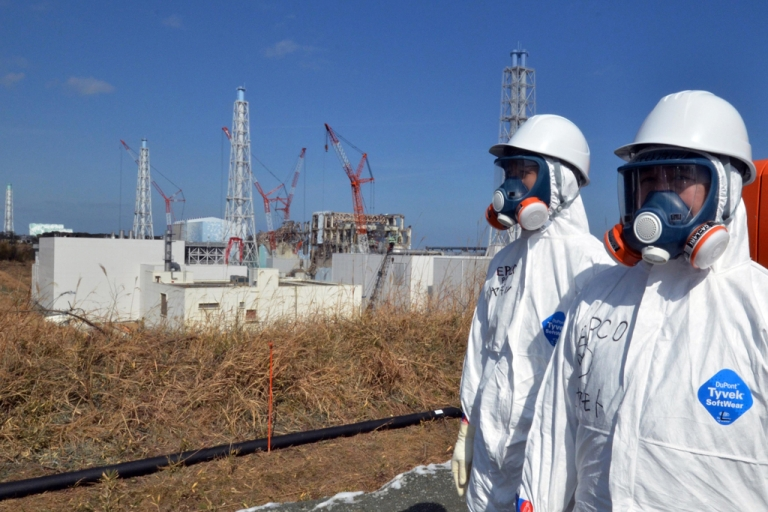 <p>This file picture taken on February 28, 2012 shows workers standing near the stricken Tokyo Electric Power Co (TEPCO) Fukushima Daiichi nuclear power plant in Okuma, Fukushima prefecture. As of March 8, 2012, Japan has closed all but two of its nuclear reactors following the disaster at Fukushima's power plant. The remaining two may be closed within the next month.</p>