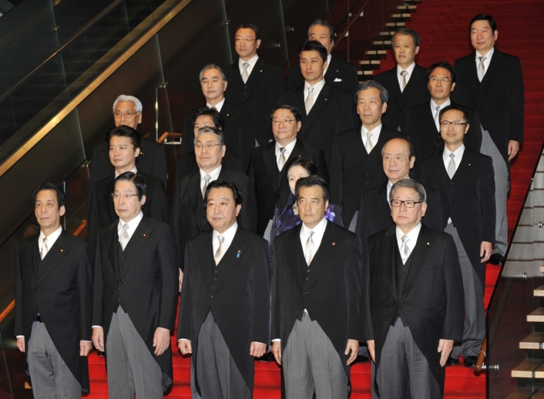 <p>Japanese Prime Minister Yoshihiko Noda (C, front) and his cabinet members pose during a photo session after their first cabinet meeting at the prime minister's official residence in Tokyo on January 13, 2012. Japan's premier reshuffled his cabinet just four months into the job in a bid to rescue his plans to raise sales tax and dig the country out from under its mountain of debt.</p>