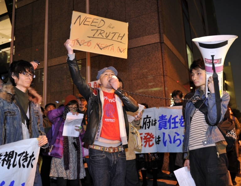 <p>Japanese civic group members hold placards to protest against Tokyo Electric Power Company (TEPCO) over the nuclear leakage at the comnpany's Fukushima nuclear power plant, following the 9.0-magnitude earthquake and tsunami outside the TEPCO headquarters in Tokyo on March 30, 2011.</p>