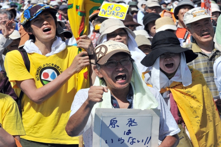 <p>People hold placards to protest against nuclear power plants in Tokyo on July 16, 2012. Tens of thousands of people rallied in Tokyo demanding an end to nuclear power, the latest in a series of anti-atomic gatherings following the tsunami-sparked disaster at Fukushima.</p>