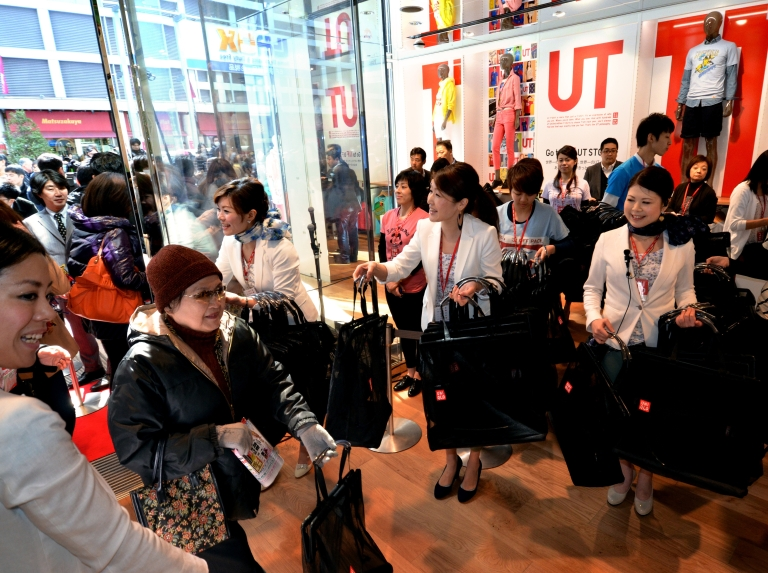 <p>Customers enter the new flagship store of Jaspanese casual fashion giant Uniqlo.</p>