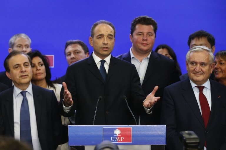 <p>Jean-Francois Cope (C) speaks to the press in Paris on Nov. 18, 2012.</p>