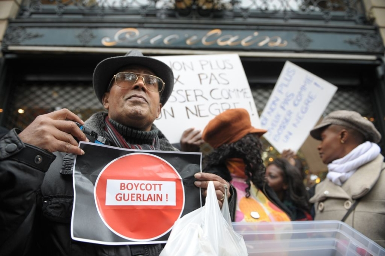 <p>Protesters outside the Guerlain perfume company's Paris store, shortly after Jean-Paul Guerlain made his comments about