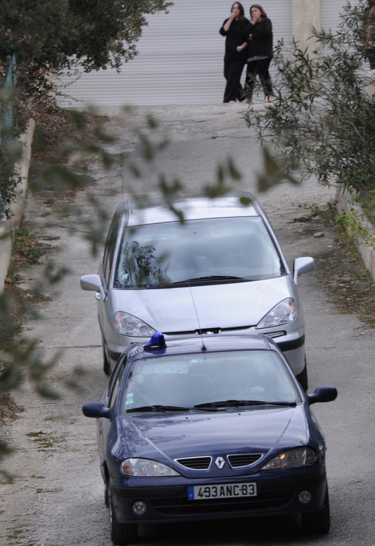 <p>The former wife and the daughter (top) of Jean Claude Mas watch as Jean-Claude Mas leaves his companion's home in a gendarmerie car (background), on January 26, 2012 in Six-Fours-les-Plages, southern France. The President of Poly Implant Prothese (PIP), who is at the center of an international health scare, was arrested by French police. Between 400,000 and 500,000 women around the world are believed to have received implants made by PIP, the now-defunct company that Mas founded in southern France.</p>