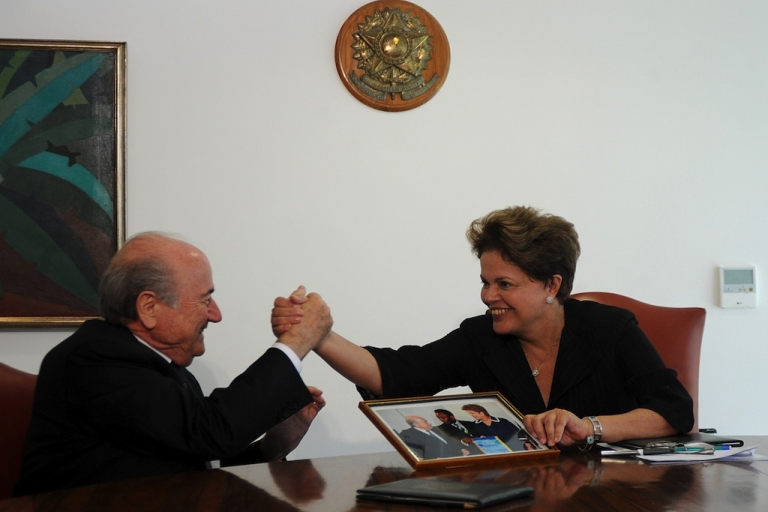 <p>Brazilian President Dilma Rousseff (R) shakes hands with FIFA President Joseph