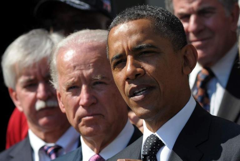 <p>President Barack Obama speaks on the American Jobs Act as Vice President Joe Biden looks on September 12, 2011 in the Rose Garden of the White House in Washington, DC.</p>