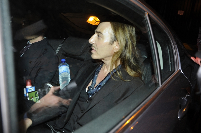 <p>John Galliano leaves in a car after he stood trial for anti-semitic insults in Paris on June 22, 2011</p>