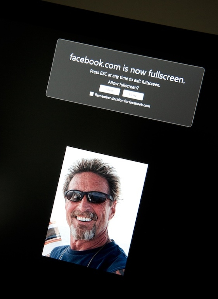 <p>This photo taken today shows a Facebook page belonging to John McAfee (pictured).</p>