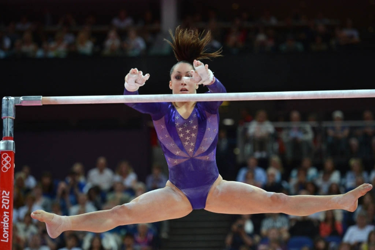 <p>US gymnast Jordyn Wieber performs on the uneven bars during the women's qualification of the artistic gymnastics event of the London Olympic Games on July 29, 2012 at the 02 North Greenwich Arena in London. Wieber stunned fans Sunday by failing to qualify for the women's All-Around final.</p>