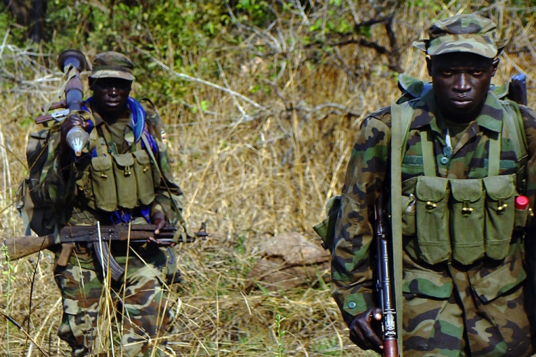 <p>Ugandan soldiers search through thick vegetation around the Congolese jungle, a longtime hideout for renegade Joseph Kony, leader with a bounty on his head of the notorious Lord's Resistance Army infamous for brutal mutilations on its human victims.</p>