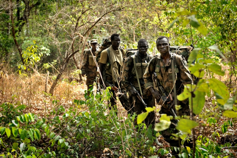 <p>Ugandan soldiers patrol on April 18, 2012 through the central African jungle during an operation to fish out notorious Lord's Resistance Army (LRA) leader Joseph Kony. A United Nations envoy said on May 11, 2012, that Kony is on the run as the manhunt to find him intensifies.</p>