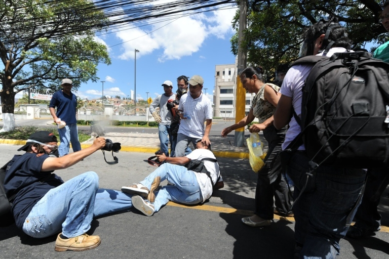 <p>Photojournalists cover a May protest in Honduras.</p>