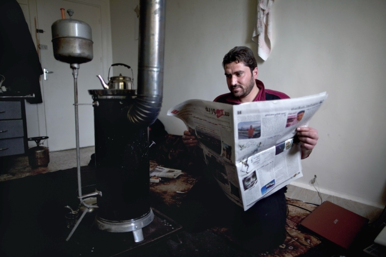 <p>Khaled al-Khatib, editor of Suria Al-Hurra (Free Syria), posing with an issue of the month-old weekly newspaper which he runs with a small group of journalists in Syria's rebel-held territories. Pictured here on Jan. 6, 2013 in Aleppo, northern Syria.</p>