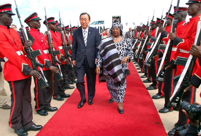 <p>UN Secretary-General Ban Ki-moon and Malawi's Vice President Joyce Banda inspect an honor guard on Ban's arrival at the airport in Lilongwe in May, 2010.</p>