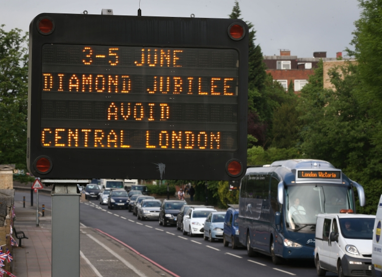 <p>A matrix road sign warns drivers of traffic problems for the extended Diamond Jubilee weekend on June 1, 2012 in London.</p>