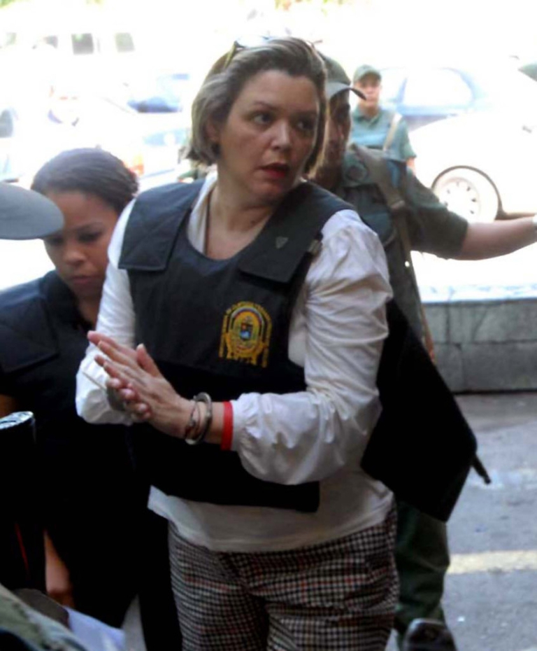 <p>Venezuelan judge Maria Lourdes Afiuni arrives under custody at the forensic clinic in Caracas on July 16, 2010. Afiuni was arrested on December 2009 charged with corruption after ordering the release of a banker accused of fraud. Noam Chomsky is appealing to President Chavez for her release.</p>