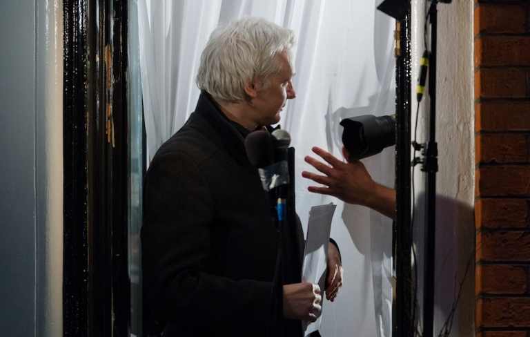 <p>Wikileaks founder Julian Assange gestures as he addresses members of the media and supporters from the window of the Ecuadorian embassy in Knightsbridge, west London on Dec. 20, 2012.</p>
