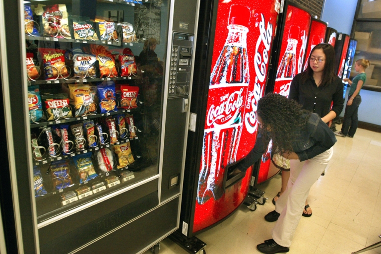 <p>Students purchase soft drinks from vending machines at Jones College Prep High School in Chicago.</p>