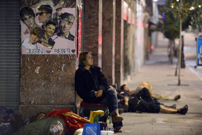 <p>Fans of Canadian pop singer Justin Bieber wait on the 20 de Noviembre Avenue ahead of Bieber's concert in Mexico City on June 11, 2012. On June 11 pop singer Justin Bibier will perform a free concert at the Zocalo Square in Mexico City.</p>
