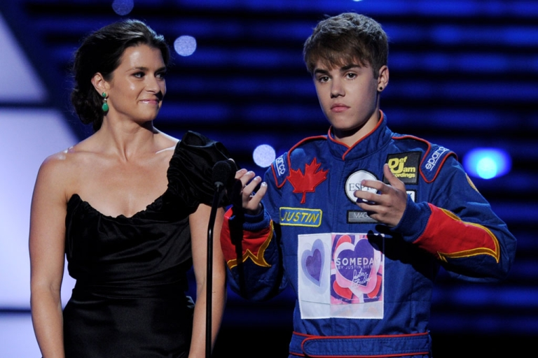 <p>Indy Car driver Danica Patrick (L) and singer/musician Justin Bieber appear onstage to present Best Team at the The 2011 ESPY Awards at the Nokia Theatre L.A. Live on July 13, 2011 in Los Angeles, California.</p>