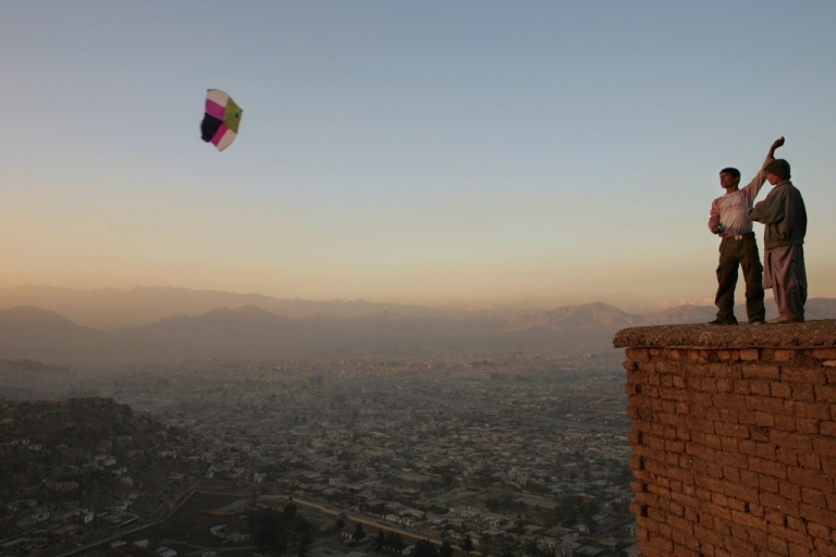 <p>Afghan boys fly a kite on a hill overlooking Kabul.</p>