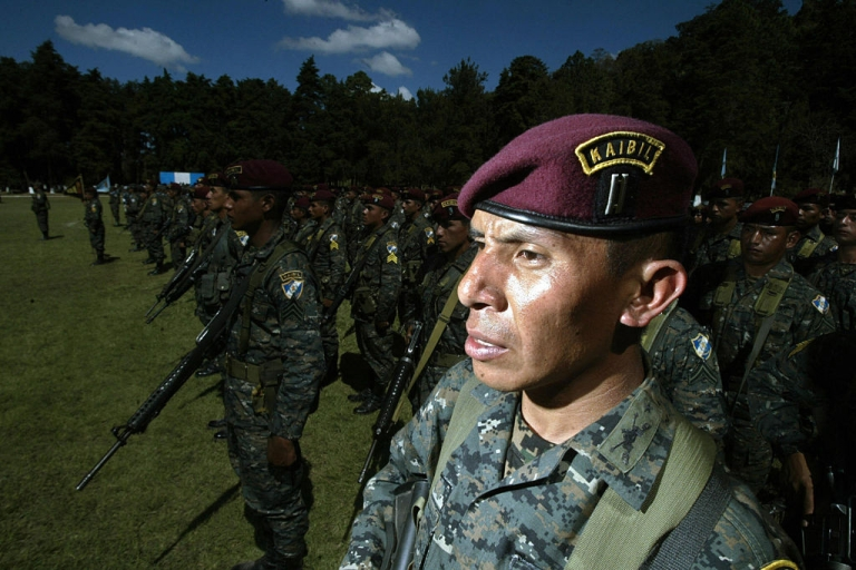 <p>Guatemalan soldiers of the Kaibiles Unit listen the speech of President Alvaro Colom (out of frame) during a ceremony at the Mariscal Zavala Brigade in Guatemala City in 2008.</p>