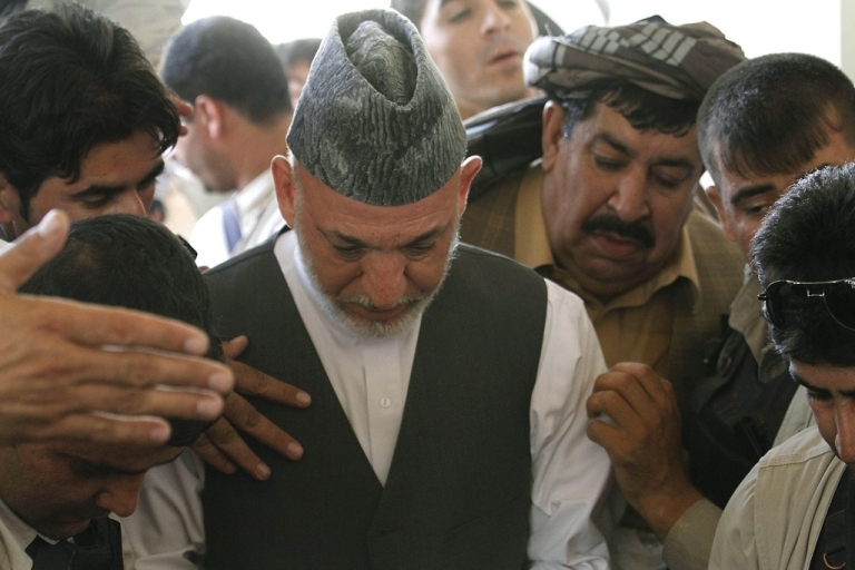 <p>Afghan President Hamid Karzai attends the last memorial service of his brother Ahmad Wali Karzai in Dand district of Kandahar province on July 13, 2011.</p>