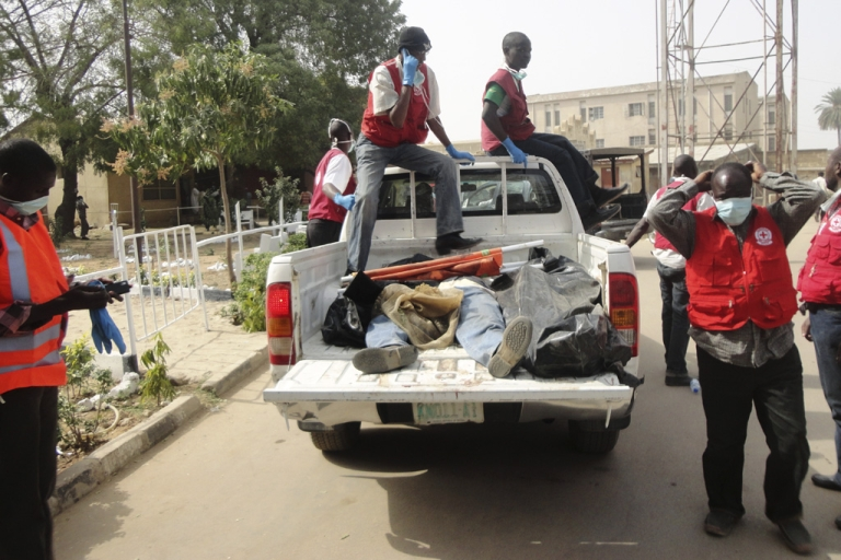 <p>Rescue workers remove bodies after multiple explosions and gunbattles erupted Friday night in Kano, Nigeria. Co-ordinated bomb attacks targeted security forces, killing dozens in Nigeria's second-largest city.</p>